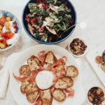 homemade crostini with burrata and prosciutto